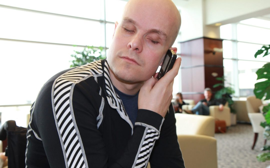Mark Pollock holding a mobile telephone as he speaks to potential sponsors